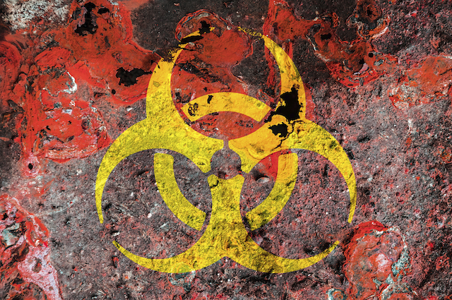 Biohazard symbol on a rust metal plate